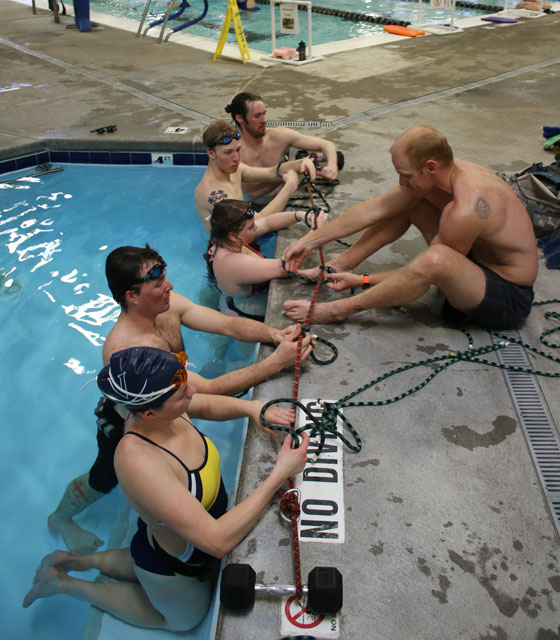 The athletes practice knots before submerging.