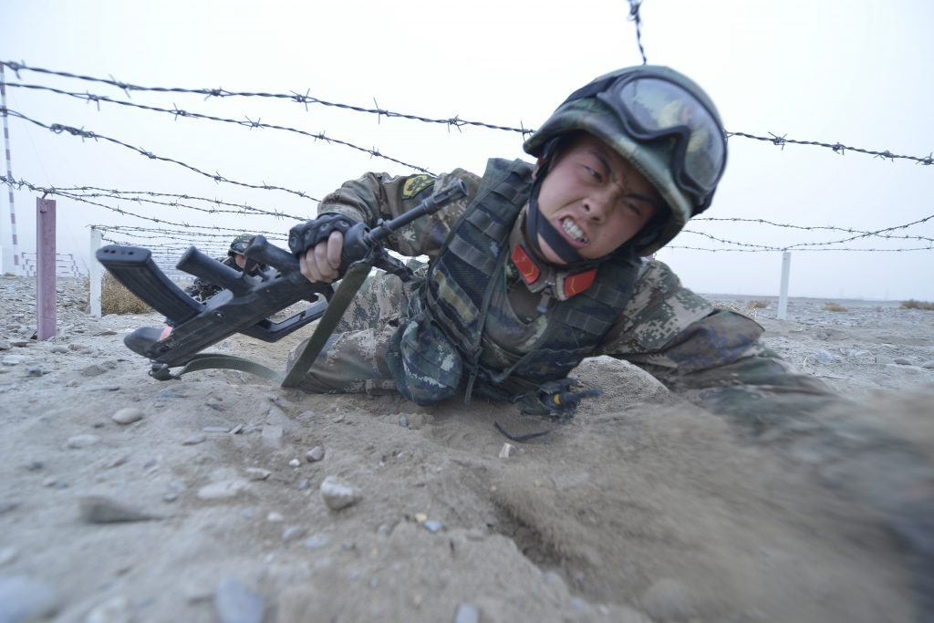 Soldiers from a special unit of the People's Armed Police in Xinjiang attend a training session in Kashgar, Xinjiang Uighur Autonomous Region, China, February 20, 2016. REUTERS/Stringer ATTENTION EDITORS - THIS PICTURE WAS PROVIDED BY A THIRD PARTY. THIS PICTURE IS DISTRIBUTED EXACTLY AS RECEIVED BY REUTERS, AS A SERVICE TO CLIENTS. CHINA OUT. NO COMMERCIAL OR EDITORIAL SALES IN CHINA. TPX IMAGES OF THE DAY - RTX27YUC